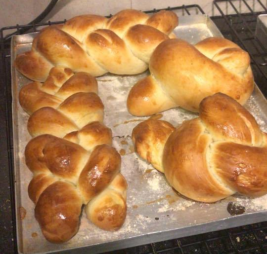 Enriched bread in braids and knots